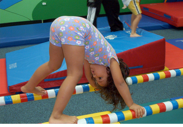 Parallel bars, doing recreational gymnastics (2.8 years).