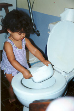 The child is independent in the bathroom (1 year 4 months).